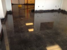 Polished concrete floor, black stain, and polished to a high gloss.