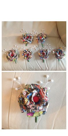 Finished buttonholes for the guys in my wedding. Paper roses made from comic book pages then jazzed up abit with bits and bobs. All cheap and easy to do