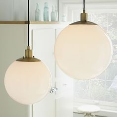 Globe Pendant - Milk Finish #westelm - could use a large one above the kitchen table and smaller ones with a shorter cord length for the hallway