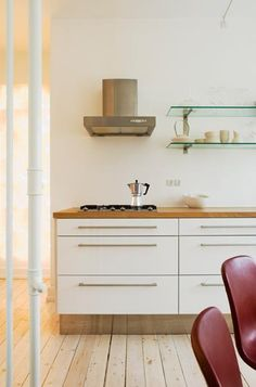 wood countertops, white cabinets