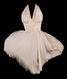 """Marilyn Monroe """"Subway"""" dress by Travilla, the most recognized costume in film history, from The Seven Year Itch. (1955) Bias cut with halter top, fitted waist, and sunburst pleats."""