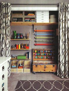 In Real Simple's April 2012 issue Jess Maurus' home office gets a makeover. Shown here is her newly organized craft closet which uses curtains instead of doors.