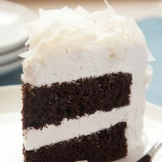 This chocolate cake recipe makes a makes a moist, delicious two layer cake that is filled and coated withmarshmallow frosting.