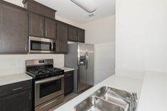Our gorgeous kitchens feature stainless steel appliances. #Apartments #Amenities #CA #IHaveArrived Apartment Communities, Stainless Steel Appliances, Luxury Apartments, Kitchens, Kitchen Cabinets, Home Decor, Decoration Home, Stainless Appliances, Room Decor