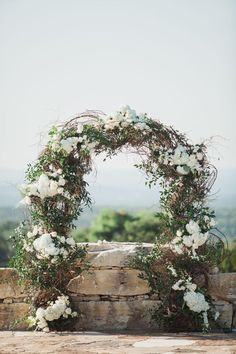 Ceremony arch, wedding arbor, white roses & hydrangeas, greenery & vines, wedding with a view, San Antonio // Jennifer Weems Photography