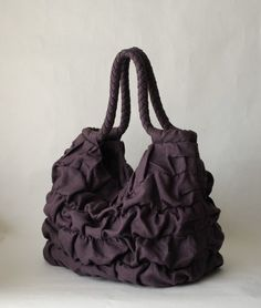 This is cuter than my grey ruffle bag....so I think I need this one, too!