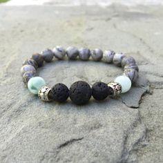 Lava rock and Jasper beaded bracelet and Jasper beaded bracelet with wellness crystals by EzzyToEden on Etsy https://www.etsy.com/listing/252073162/lava-rock-and-jasper-beaded-bracelet-and