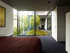 House S by Keiji Ashizawa Design.  Second floor courtyard between two bedrooms.