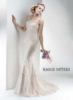 Intricate beaded embroidery with shimmering metallic threading and dazzling Swarovski crystals adorn this lightweight tulle sheath wedding dress by Maggie Sottero, complete with stunning illusion keyhole back.