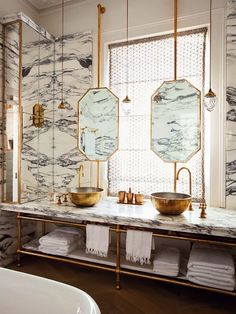 I really like the elements of this bathroom, the mirrors in front of the window hanging from the wall, open shelving with brass towel bar