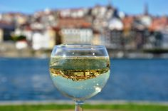 Porto in a glass of vinho verde  #reflection #douro #oporto #porto #oldtown #glass #wine #river Photograph by  Heike Kropp