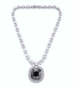 A RARE COLORED DIAMOND PENDANT NECKLACE  Price realised  USD 352,000 Estimate  USD 100,000 - USD 200,000