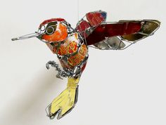 Hummingbird from recycled tin and wire