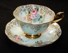 ROYAL ALBERT ROSE BOUQUET BLUE WHITE GOLD TEA CUP AND SAUCER