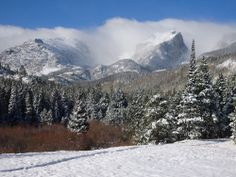 Snow and low clouds blanket the mountains and trees in this wintry scene of Rocky Mountain National Park in Colorado. The park contains 150 lakes, 359 miles (578 kilometers) of trails and 72 peaks higher than 12,000 feet (3,700 meters).Rocky Mountain National Park is home to a variety of large mammals, including elk, bighorn sheep, black bears, moose and mountain lions. [Related: Top 10 Most Visited National Parks]