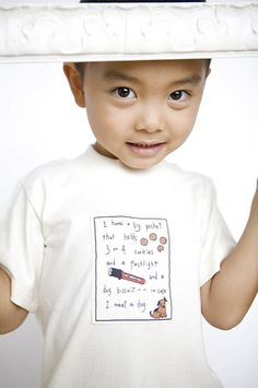 "Short sleeve 100% organic cotton t-shirt with adorable message: ""I have a big pocket that holds 3 or 4 cookies and a flashlight and a dog biscuit -- in case I meet a dog."" Sizes 12 mos to Youth 5."