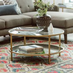 The Belham Living Lamont Round Coffee Table - Gold doubles down with clear tempered glass and the inviting glimmer of gold. The simplicity of tubular. Round Glass Coffee Table, Coffee Table With Shelf, Small Coffee Table, Coffee Table Design, Round Coffee Table, Decorating Coffee Tables, Living Room Table Sets, Living Room Red, Interior Design Living Room