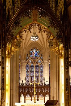 The amazing interior of St. Patrick's Cathedral, New York City. St. Patrick's is  located on the east side of Fifth Avenue between 50th and 51st Streets in midtown Manhattan, directly across the street from Rockefeller Center and specifically facing the Atlas statue.
