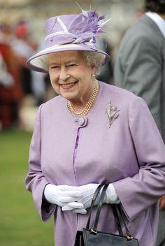 Queen Elizabeth II attends a garden party at Buckingham Palace