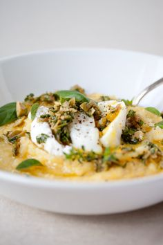 Eggsolenta by Danielle of The Trail of Crumbs: Poached eggs over polenta with olive-herb pesto! via thekitchn #Eggs #Polenta