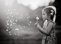 in the breeze kate luber photography girl blowing dandelion black and white oklahoma city
