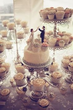 this is so pretty, and this way, the actual cake could be for close family, and the cupcakes for everyone else