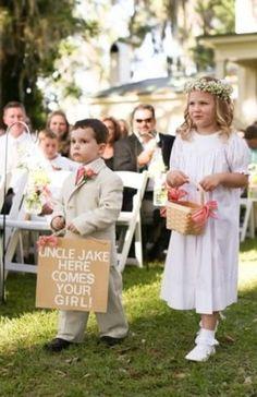 Sweet flower girl and ring bearer walking down the aisle
