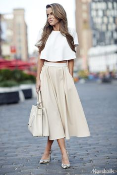 Lady like. Pair a short-sleeved crop top with a flowy skirt for a little added flair. Just add a neutral tote and a pair of snakeskin heels.