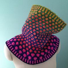 Cowls are fun to knit projects, but their simple tube shapes always leave me with a triangle of uncovered chest even when my coat is buttoned all the way up. I designed this top-down fair isle cowl with a tailored flare so that this cowl would not only snuggle up over my