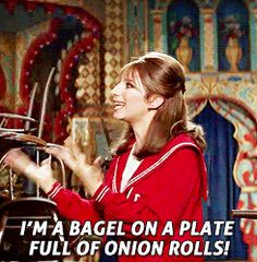 I'm a bagel on a plate full of onion rolls!