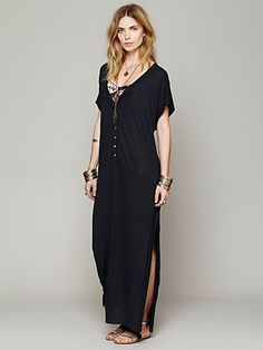 Free People Marrakesh Dress Semi-sheer maxi dress with button placket front, scoop neck and side slit. Long slit up each side. Throw this over a bikini for a day at the beach and tie the bottom together for a casual cool look. $88.00 in steel. So cute and comfy. Simple, but stylish.