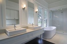 Custom Bathroom Design and Remodel. Call today to speak with a professional about Custom Bathroom Renovation Modern White Bathroom, Double Sink Bathroom, Beautiful Bathrooms, Master Bathroom, Double Sinks, White Bathrooms, Master Baths, Mirror Bathroom, Modern Bathrooms