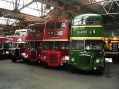 """""""Museum of Transport in Manchester"""" by Mikey from Wythenshawe, Manchester, UK - Flickr image A display of buses. Licensed under CC BY 2.0 via Wikimedia Commons."""