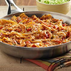 Chicken Enchilada Skillet - The flavor of an enchilada recipe made quickly in a skillet with torn corn tortillas, cooked chicken, zesty tomatoes and sauce with cheese.