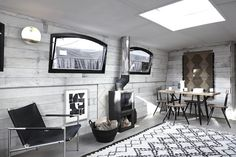 Unusual places to stay: Bert's barge in London. Wood burning stove, beni ourain rug....:)