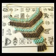 "⭐UNIQUE!⭐ Southwest Tribal Necklace Glass &Wood!⭐ Very Unique Statement BIB Southwest Tribal Necklace. Rows of Turquoise Glass beads and brown wood stained beads  Silvertone chain link length 22""   Bib hangs down 6""  Nice!!! Jewelry Necklaces"