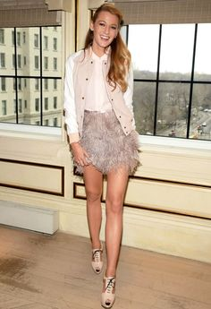 Blake Lively highlighted her mile-long stems in a flirty feathered miniskirt at a fashionable luncheon at Bergdorf Goodman's BG restaurant in NYC on Tuesday, February 9, 2016.