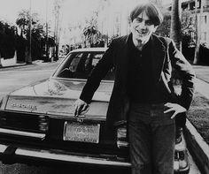 Robert de Niro poses in front of his shiny Mercedes, July 1975