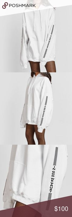 """Danielle Guizio Checkered Saint Oversized Hoodie CHECKERED SAINT OVERSIZED HOODIE. """"IN GOD WE TRUST"""" Brand New in the original bag. Out of stock online! IN GOD WE TRUST  Oversized Hoodie Model is wearing a size SM Danielle Guizio Tops Sweatshirts & Hoodies"""