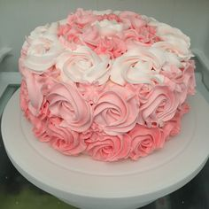 Pink ombré rose cake. Vanilla sponge filled with raspberry cream and topped with rose water swiss merengue buttercream roses. Made by Natalie Baxter