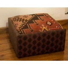The seat of this ottoman is from an old kilim, woven near Kars, eastern Turkey. Amid soft pink and beige hues are traditional motifs typical of Anatolian kilims–the burdock burr, a protective symbol that suggests abundance