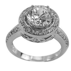 This antique diamond engagement ring can accommodate between a 1.25ct and 1.75ct center diamond.