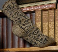 Socks featuring the opening lines from Beowulf http://www.ravelry.com/patterns/library/hwaet