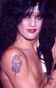 Tommy Lee Turns His Life, In Heather, Pamela, Mayte, And Mighty Mouse Tattoos Tommy Lee Motley Crue, Rock Star Hair, Drum Tattoo, Shout At The Devil, Mighty Mouse, 80s Hair Bands, Heather Locklear, Mouse Tattoos, Bret Michaels