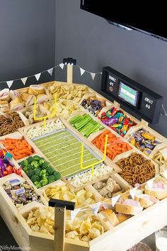Amp Up Your Super Bowl Party With a DIY Snackadium (AKA Snack Stadium)! Looking for ideas for a super football party? Check out this round up. From easy to intense, these impressive spreads of appetizers will seriously impress your guests. If you're thinking about how to build one, you need to see this.