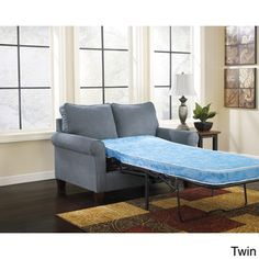 @Overstock - Signature Design by Ashley Zeth Denim Sleeper Sofa - This modern sofa from Ashley Furniture features casual denim blue upholstery wrapped around plush pillow back cushions, rolled arms and a sleek frame. Give your overnight guests a comfortable place to rest with this full, twin or queen sleeper sofa.  http://www.overstock.com/Home-Garden/Signature-Design-by-Ashley-Zeth-Denim-Sleeper-Sofa/8897186/product.html?CID=214117 $739.99