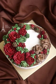 'Tis the season to be jolly and to have a one of a kind and ultra festive cake like this beautifully decorated and super tasty Christmas Buttercream Wreath Cake.