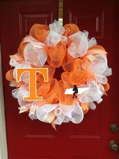University of Tennessee Football inspired wreath for my Sister in Law.bc I dont cheer for the Volz haha :) Tennessee Girls, Tennessee Football, University Of Tennessee, Ut Football, Titans Football, Wreath Crafts, Diy Wreath, Diy Crafts, Deco Mesh Wreaths