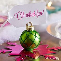 """Present"" them with merry place card holders. A fun table idea that sings *we wish you a Merry Christmas!*"