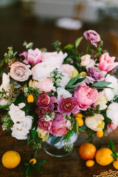 garden rose centerpieces - photo by Redfield Photography http://ruffledblog.com/one-table-three-ways